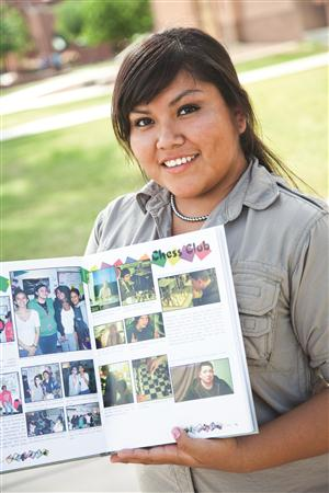 Student with yearbook